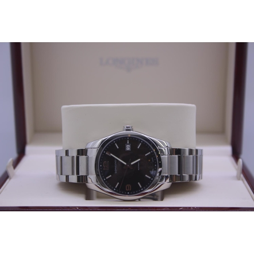 14 - BOXED BRAND NEW LONGINES GENTS FULL STEEL WRIST WATCH COMPLETE WITH MIDNIGHT BLACK DIAL , 2 YEARS IN...