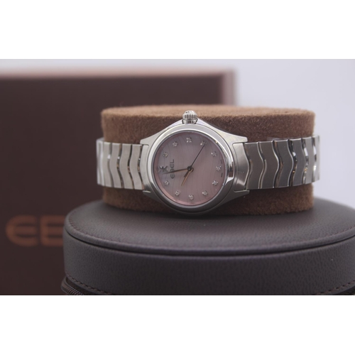 5 - BOXED BRAND NEW EBEL LADIES FULL STEEL RIST WATCH COMPLETE WITH MOTHER OF PEARL AND DIAMOND DOT DIAL...