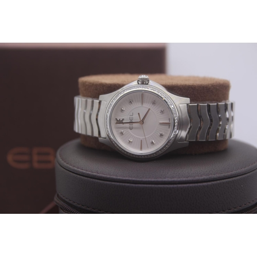 8 - BOXED BRAND NEW EBEL UNISEX MID SIZE STEEL WIRST WATCH COMPLETE WITH DIAMOND BEZEL AND DIAMOND DOT D...