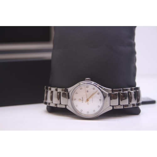 31 - BOXED BRAND NEW RADI LADIES BLACK CERAMIC WRIST WATCH COMPLETE WITH A MOTHER OF PEARL AND DIAMOND DO...