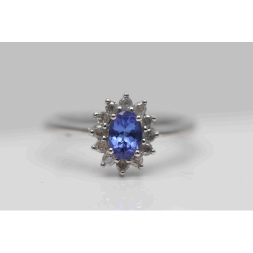 218 - **£795.00** 9CT WHITE GOLD 6MM BY 4MM OVAL SAPPHIRE AND BRILLIANT CUT DIAMOND OVAL CLUSTER RING (0.5...