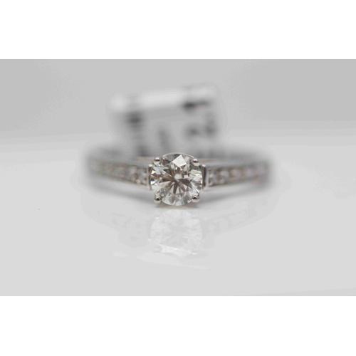 233 - **£3,250.00** 18CT WHITE GOLD BRILLIANT CUT DIAMOND SOLITAIRE RING WITH BRILLIANT CUT DIAMOND SHOULD...