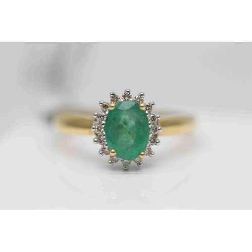 260 - **£1,545.00** 18CT YELLOW & WHITE GOLD 10MM BY 8MM OVAL EMERALD AND BRILLIANT CUT DIAMOND CLUSTER RI...