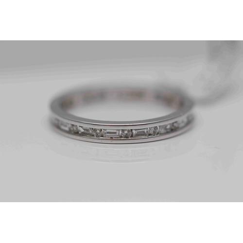 266 - **£2,100.00** 18CT WHITE GOLD BRILLIANT CUT AND EMERALD CUT DIAMOND FULL BAND RING (0.60 CARAT) COLO...