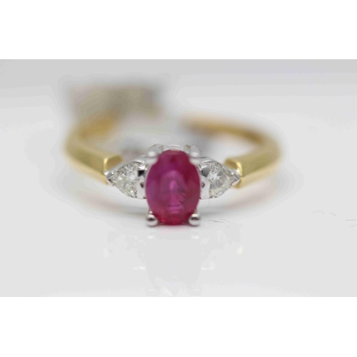 273 - **£1,950.00** 18CT YELLOW & WHITE GOLD SOLITAIRE 7MM BY 5MM OVAL RUBY WITH HEART SHAPED DIAMOND SHOU...