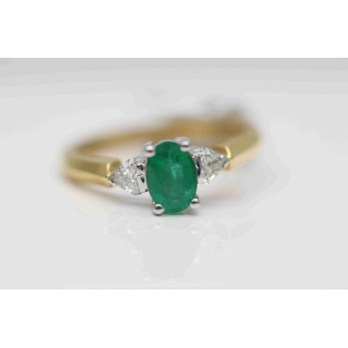 275 - **£1,750.00** 18CT YELLOW & WHITE GOLD 7MM BY 5MM OVAL EMERALD AND HEART SHAPED DIAMOND SHOULDERS RI...