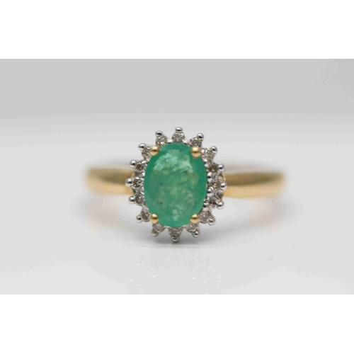 288 - **£1,950.00** 18CT YELLOW & WHITE GOLD 8MM BY 6MM OVAL CUT EMERALD AND BRILLIANT CUT DIAMOND RING, D...