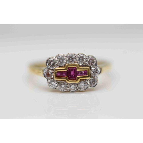 296 - **£1,100.00** 18CT YELLOW & WHITE GOLD BRILLIANT CUT DIAMOND AND EMERALD CUT RUBY STONE RING (0.30 C...