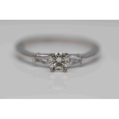 302 - **£2,350.00** PLATINUM BRILLIANT CUT DIAMOND SOLITAIRE RING WITH TAPERED BAGUETTE SHAOED DIAMOND SHO...