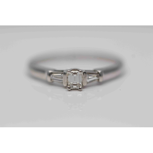 306 - **£1,450.00** 9CT WHITE GOLD EMERALD CUT SOLITAIRE DIAMOND RING WITH TAPERED BAGUETTE DIAMOND SHOULD...