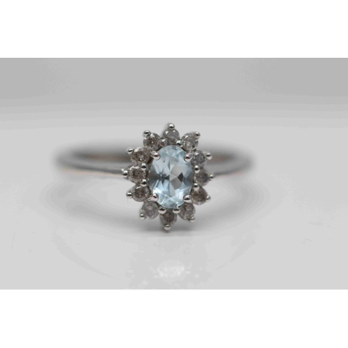 321 - **£1,250.00** 9CT WHITE GOLD 7MM BY 5MM OVAL AQUAMARINE AND DIAMOND CLUSTER RING (0.25 CARAT DIAMOND...