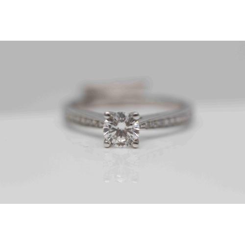 325 - **£3,290.00** 18CT WHITE GOLD BRILLIANT CUT DIAMOND SOLITAIRE RING WITH DIAMOND SHOULDERS, DIAMOND S...
