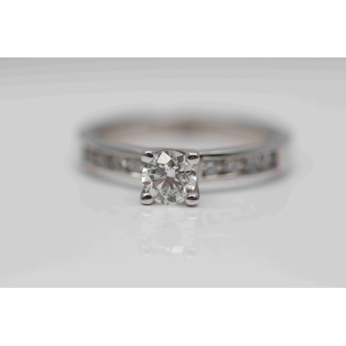 331 - **£3,950.00** 18CT WHITE GOLD BRILLIANT CUT SOLITAIRE DIAMOND RING, WITH DIAMOND SHOULDERS CENTRE ST...