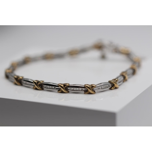353 - **£1,985.00** 9CT YELLOW AND WHITE GOLD BRILLIANT CUT DIAMOND BRACELET DIAMOND WEIGHT (0.50CARAT) CO...