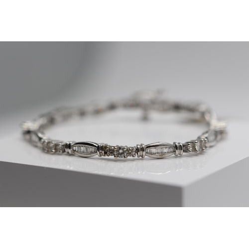 357 - **£4,950.00** 9CT WHITE GOLD BRILLIANT CUT AND BAGUETTE CUT SHAPED DIAMOND BRACELET 3.00 CARAT TOTAL...