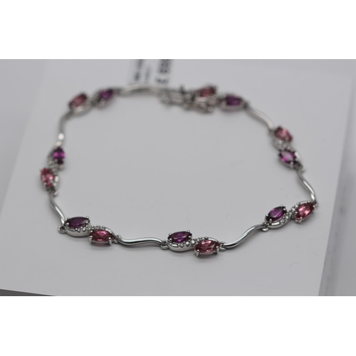 373 - **£1,695.00** 9CT WHITE GOLD PINK SAPPHIRE AND DIAMOND BRACELET VALUE £1695 (AB017)...