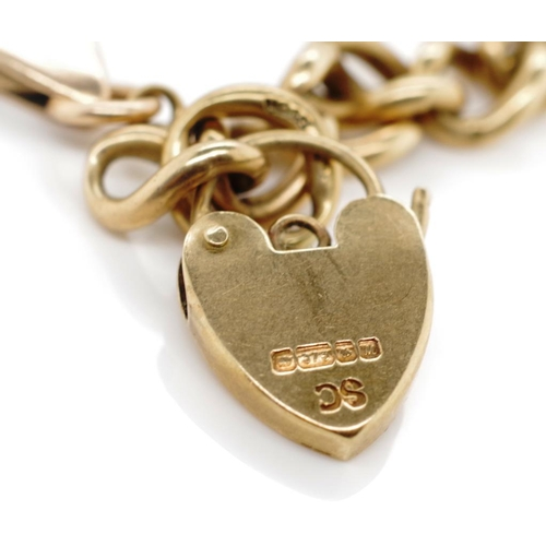 39 - 9ct gold bracelet and charm. Large Cuban link bracelet with heart locket charm. Chain marked 375 to ...
