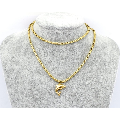 12 - Gold dolphin pendant and chain Marked 375 to charm and rubbed Italian marks to chain. Approx weight ...