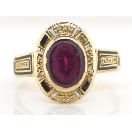 29 - Antique gold, enamel and garnet ring unmarked approx 2.85 grams, ring size N. * Showing some loss to...