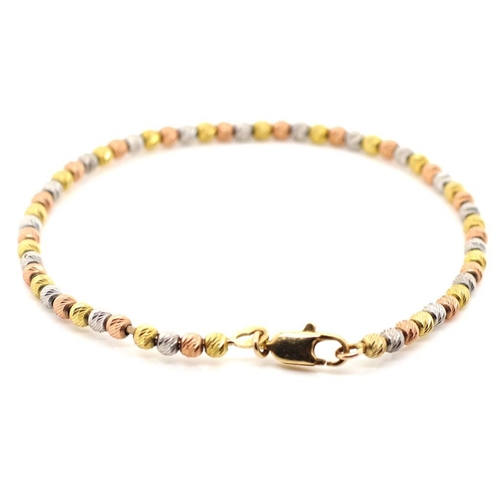 48 - Tri colour 9ct gold beaded bangle white, yellow and red gold beds threaded on a single piece of 0.8m...