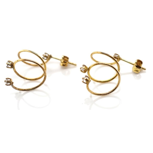 53 - 9ct gold spiral earrings set with white gems stones marked 375 approx 1.2 grams...