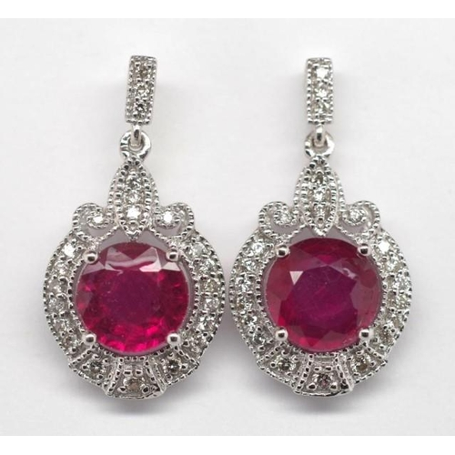 101 - Ruby, diamond and 18ct white gold earrings Victorian style with fine mille grain and scroll settings...