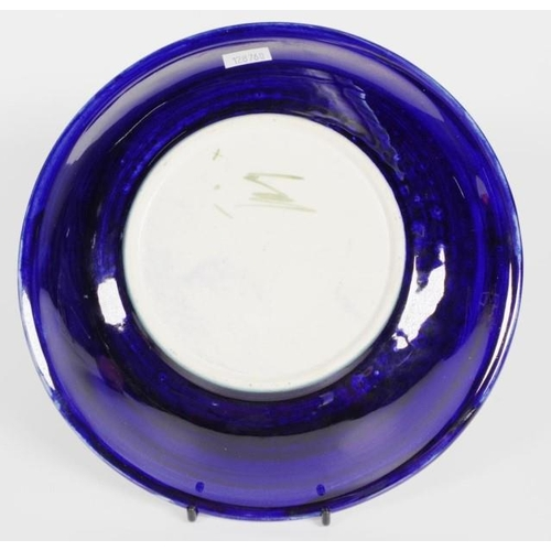 1012 - Walter Moorcroft ' Magnolia' shallow bowl decorated on cobalt blue ground, signature to base, (diame...