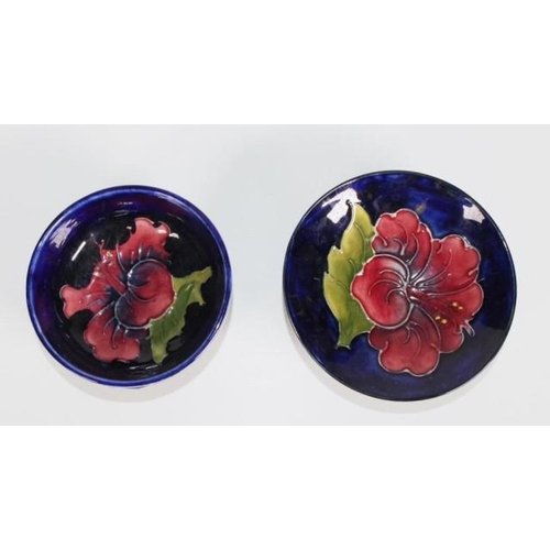 1026 - Two Walter Moorcroft 'Hibiscus' bowls each decorated on cobalt blue ground, marked to bases, (diamet...