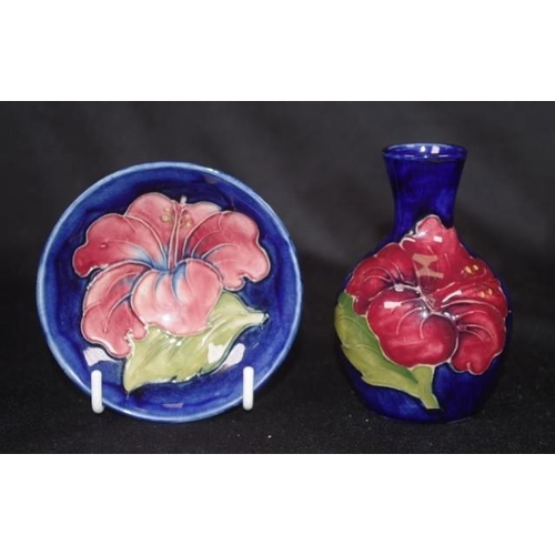 1035 - Two Walter Moorcroft 'Hibiscus' pieces including posy vase, (height 10cm approx), and small bowl, (d...