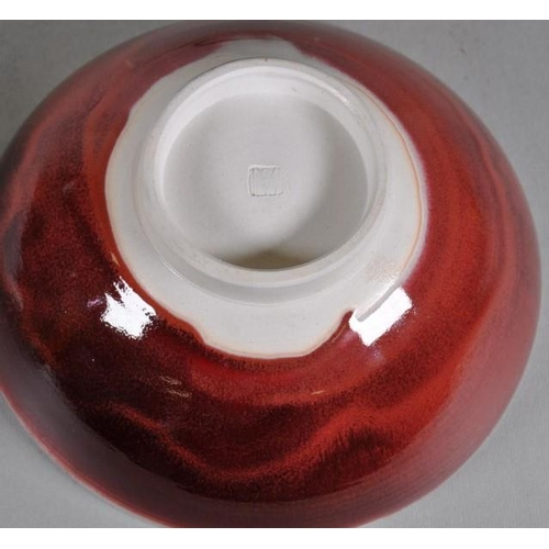 1045 - Susie McMeekin (b1954) Australian pottery bowl red glaze, studio mark to base, 25cm diameter approx....