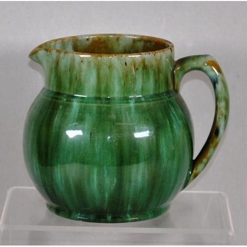 1047 - John Campbell Australian pottery jug green glaze, base inscribed J.C. 1933, 14cm high approx....
