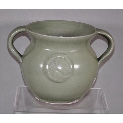 1054 - Susie McMeekin (b1954) Australian pottery vase twin handled, light green glaze, impressed studio mar...