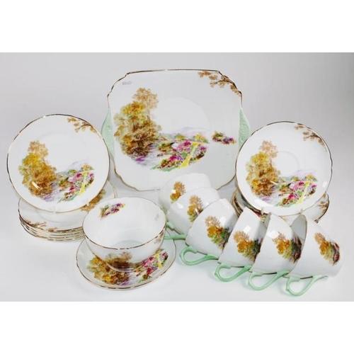 1063 - Twenty piece Shelley 'Heather' tea set including 6 trios, a sugar bowl, and a cake plate, marked to ...