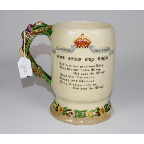 1075 - George VI 1937 commemorative coronation mug marked for Crown Devon Fieldings, with music box to base...