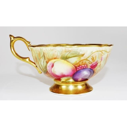 1078 - Aynsley fruit decorated display cup gilt interior and handle, marked to base, (height 7cm approx)....