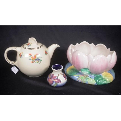 1084 - Two various Clarice Cliff ceramic tableware pieces including floral decorated teapot, (height 17cm a...