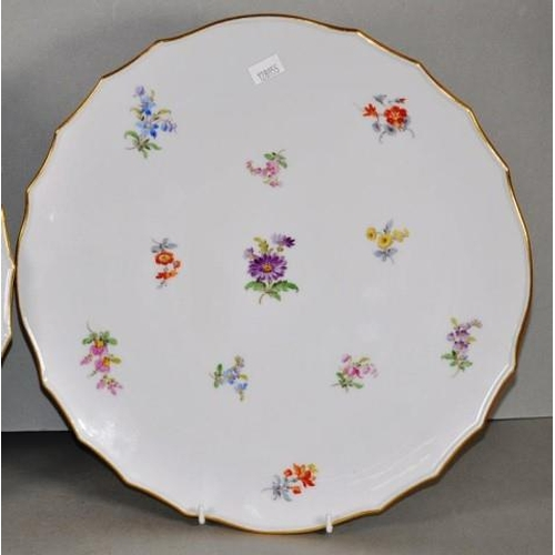 1111 - Pair of Meissen hand painted platters 31cm diameter approx., each with floral decoration & crossed s...