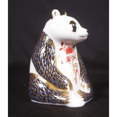 1120 - Royal Crown Derby Panda paperweight marked to base and with gold button, (height 10cm approx)....