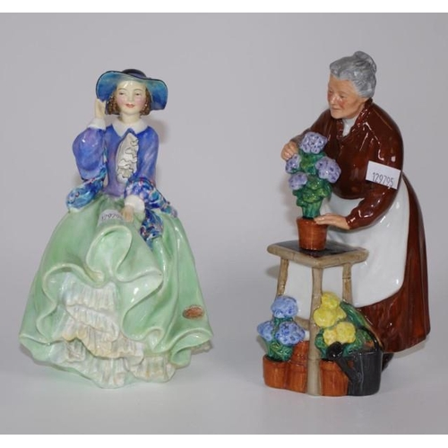 1128 - Two Royal Doulton figurines comprising Top o'the Hill, 19cm high approx., HN1833 & Flora HN2349,...