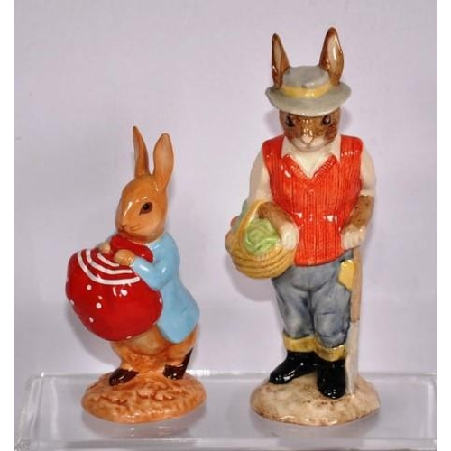 1134 - Two various rabbit figurines to include a Beswick gardener rabbit height 15.5cm approx, and a Beatri...