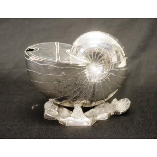 1169 - Victorian silver plate spoon warmer nautilus form, on seashore form base, (height 14cm approx)....