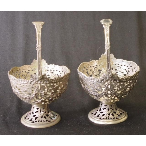 1228 - Pair continental silver sweetmeat baskets pierced floral decoration, with swing handles, marked 800 ...