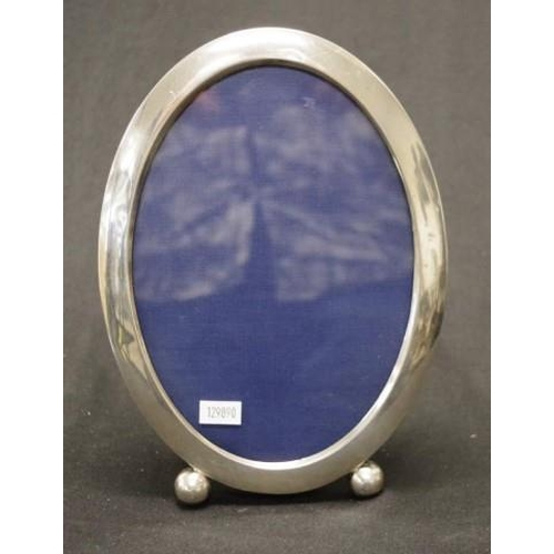 1231 - Large sterling silver oval photo frame stamped STERLING, easal form. 23cm high...