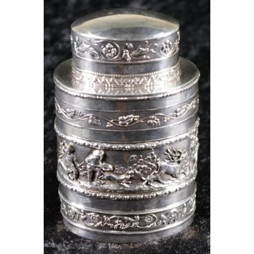 1233 - Continental silver tea caddy extensively decorated with figures in a hunting scene, and embossed lea...
