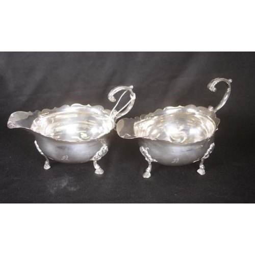 1263 - Pair Georgian sterling silver sauce jugs (possibly) London 1781), marks rubbed, tri-footed, (height ...