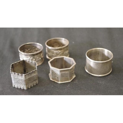 1265 - Five various sterling silver napkin rings mostly English hallmarks, 104g approx....