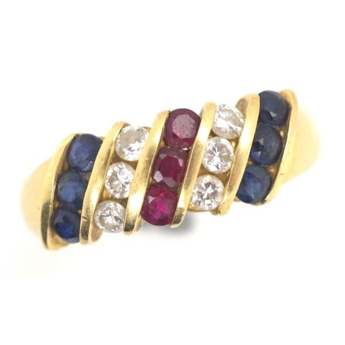 129 - Diamond, ruby, sapphire and 18ct gold ring marked 750, channel set with approx 6x blue sapphire tota...