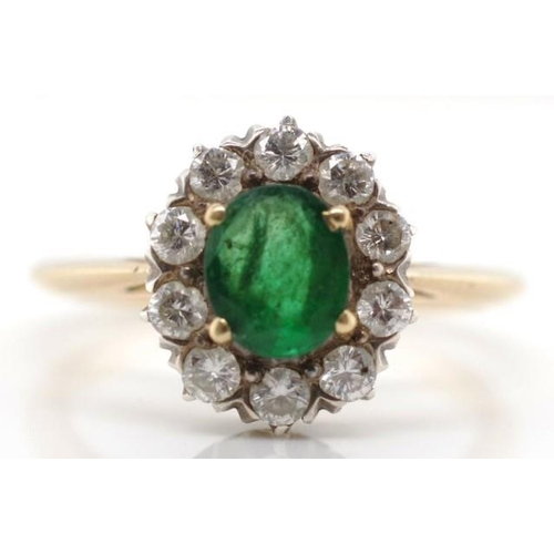 131 - Emerald, diamond and 14ct yellow gold cluster ring unmarked approx 8mm x 6mm oval emerald and 10x ro...