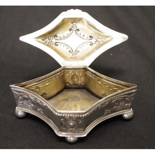 1310 - Continental silver lidded trinket box embossed decoration to lid and sides of box, on 4 ball feet, (...