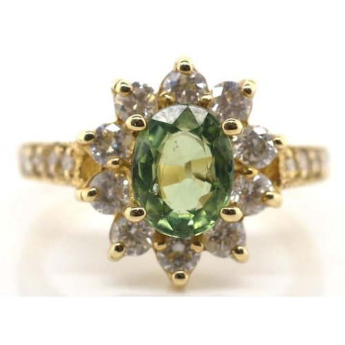 132 - Tourmaline, diamond and gold ring marked k14 gold cluster ring set with a oval cut green tourmaline ...